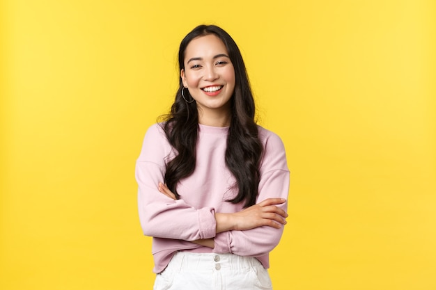 Asian woman on yellow background.
