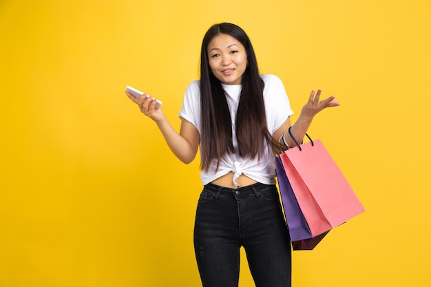 Asian woman on yellow