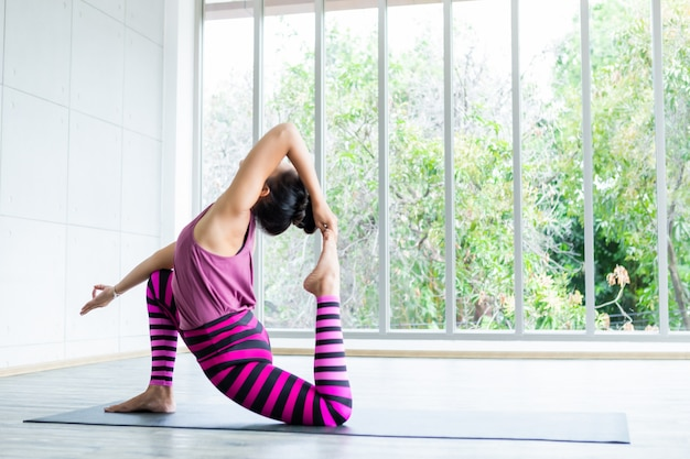 Asian womean practicing yoga
