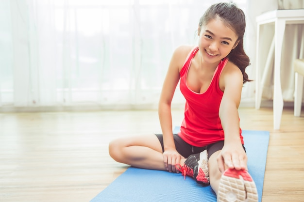 Asian women are exercising at home