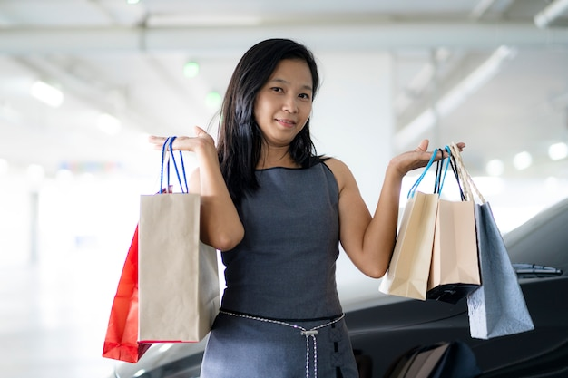 Asian women are happy shopping at department stores, shopping bags