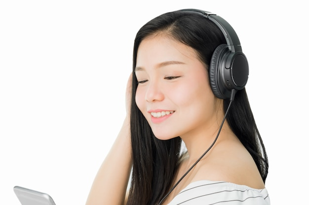 Asian women are listening to music from black headphones