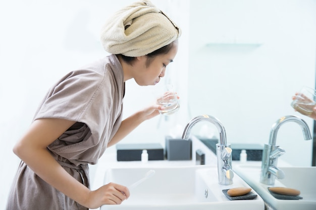Asian women are mouthwash
