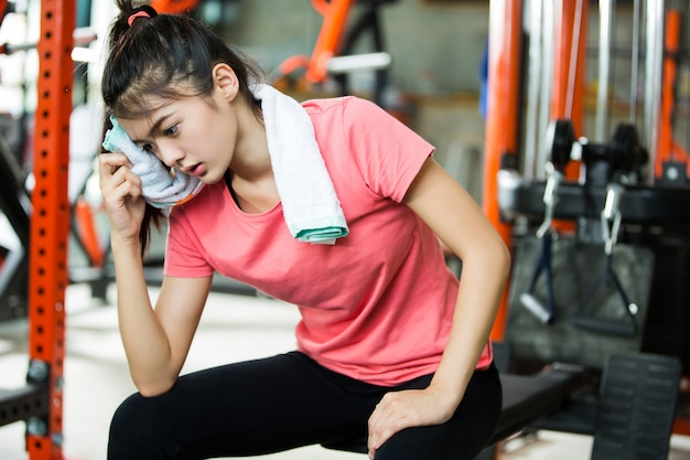 Asian women are resting after a workout gym