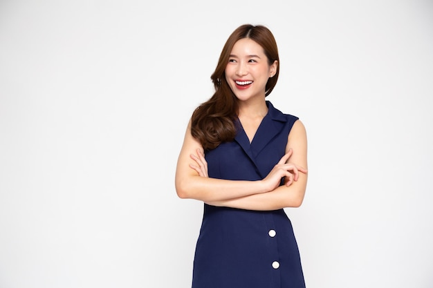 Asian women in blue dress with arms crossed and smile isolated on white