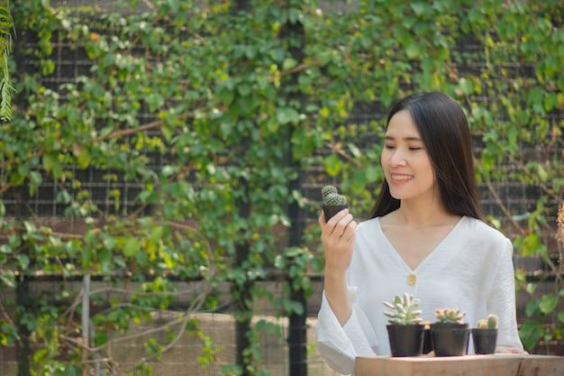 Asian women home gardening cactus in home garden