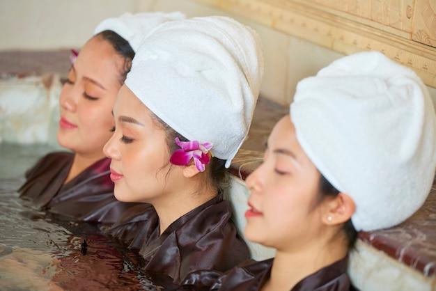 Asian women in hot tub