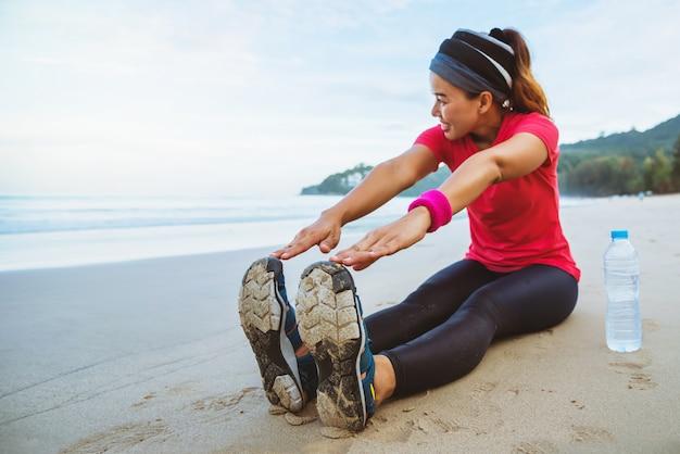 Asian women jogging workout on the beach