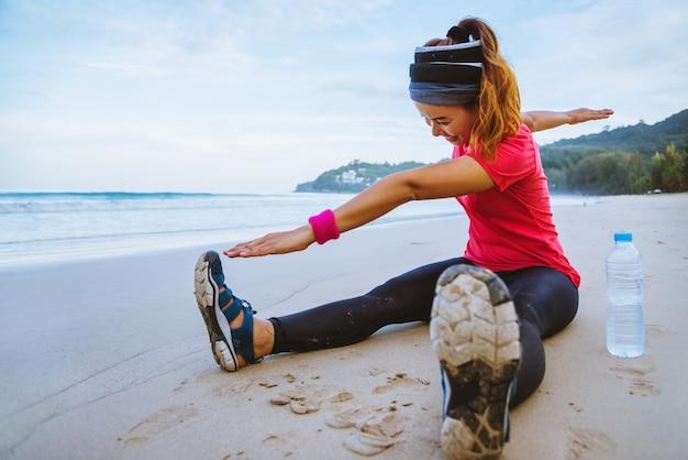Asian women jogging workout on the beach.