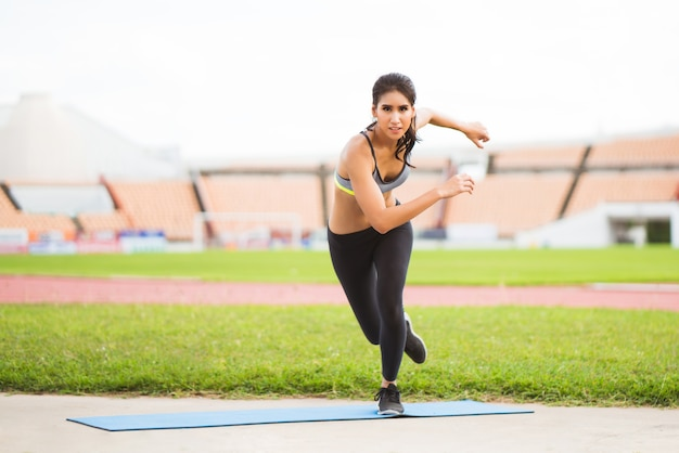 Asian women outdoor exercise, athletic field