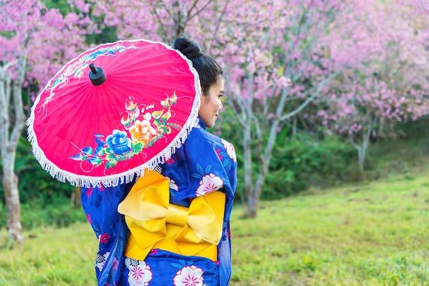 Asian women a portrait of japanese kimono woman and cherry blossom