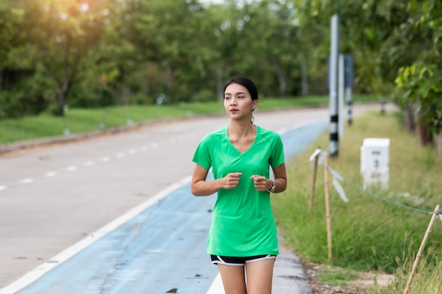 Asian women running in evening