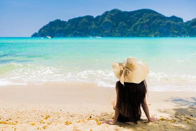Asian women sitting on the beach at koh phi phi. krabi, thailand
