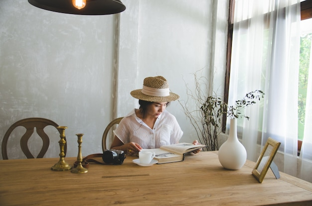 Asian women sitting and reading book