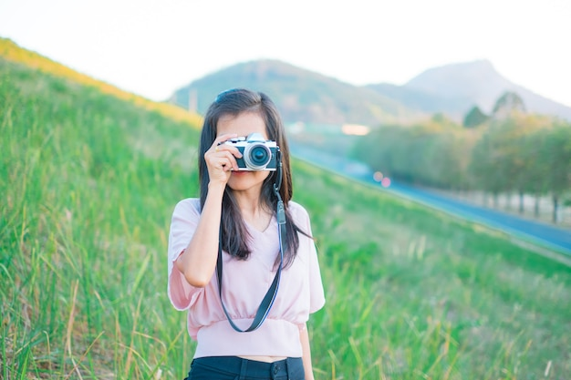 Asian women standing she taking pictures happy of outdoor summer on mountain and green view
