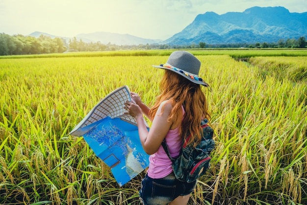 Asian women travel relax in the holiday. expand survey map mountain field. thailand