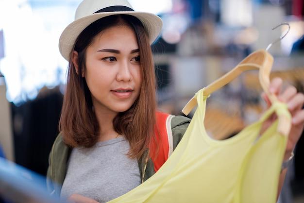 Asian women travel shopping.