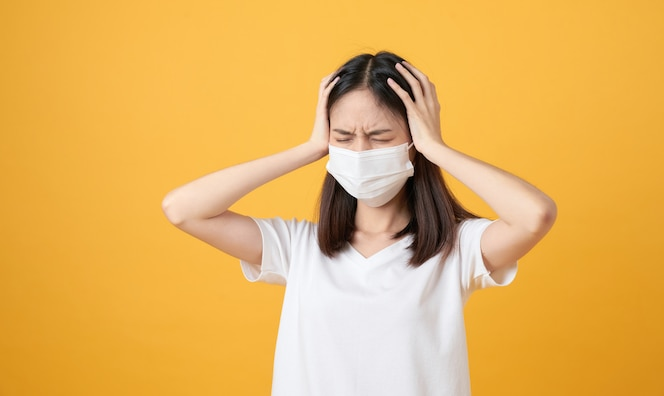 Asian women wear masks to protect disease and the headache from a virus