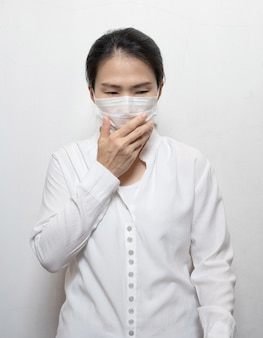 Asian women wearing masks to cover  face, nose and mouth