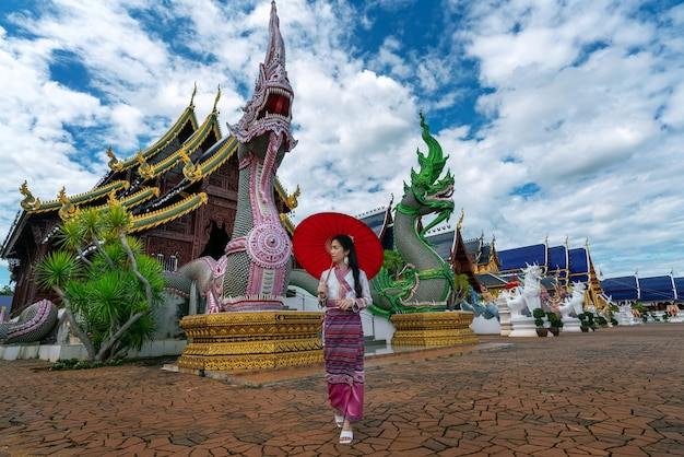 Asian women wearing thai dress costume traditional according thai culture at temple in chiang mai