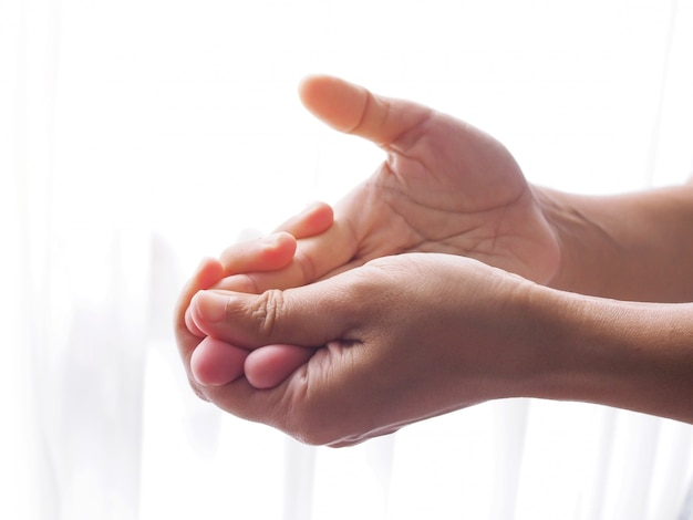 Asian women with finger pain, hand pain and numbness.