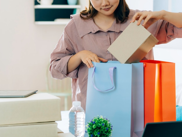 Asian women with her freelance job business online seller.