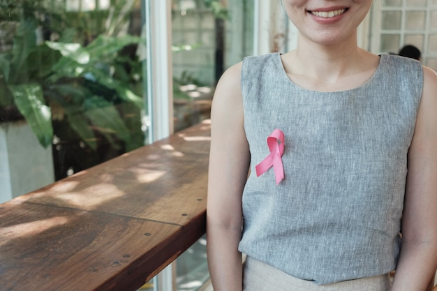 Asian women with pink ribbon, breast cancer awareness, october pink