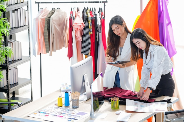 Asian women at work are fashion designers and tailors