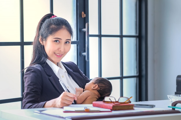 Asian women working in business and raising children at home