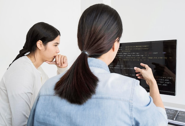 Asian women working on a programming code