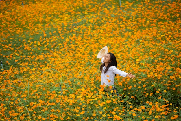 Asian women in yellow flower farm