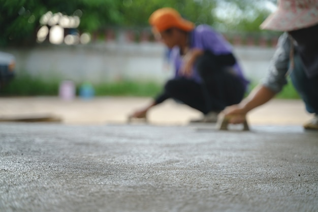 Asian worker labor working with concrete cement floor