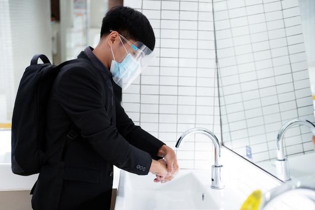 Asian working men wash in public toilets