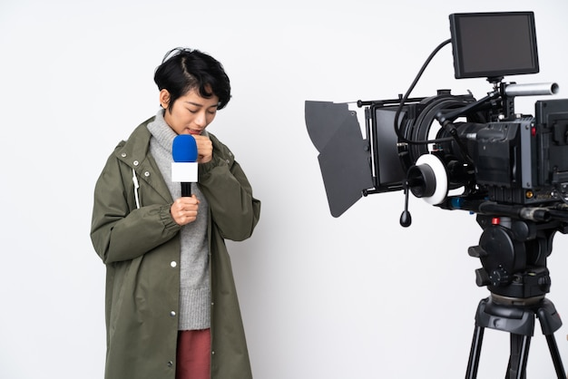 Asian young beautiful reporter woman over white wall