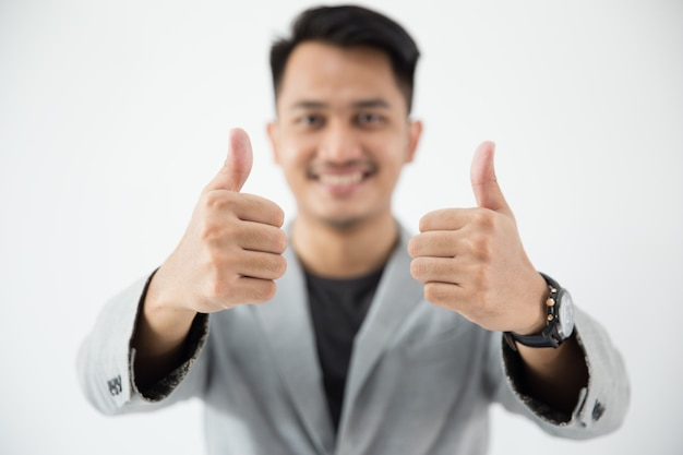 Asian young business thumb up