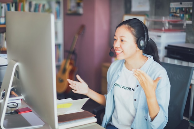 Asian young business woman video call from home office.