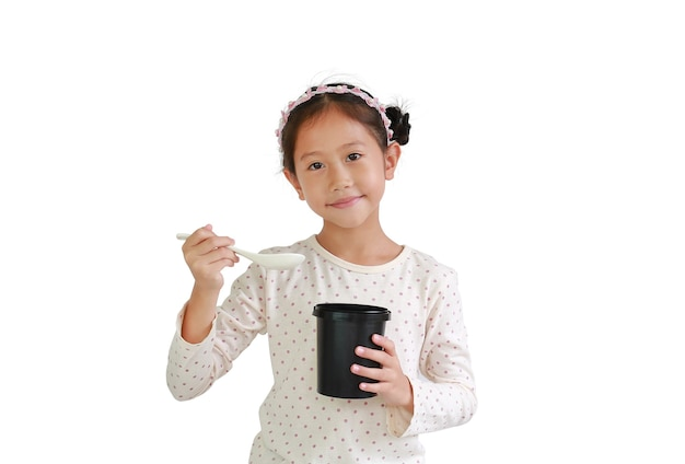 Asian young girl child hold and eating food from black cup isolated on white background. food and advertising concept.