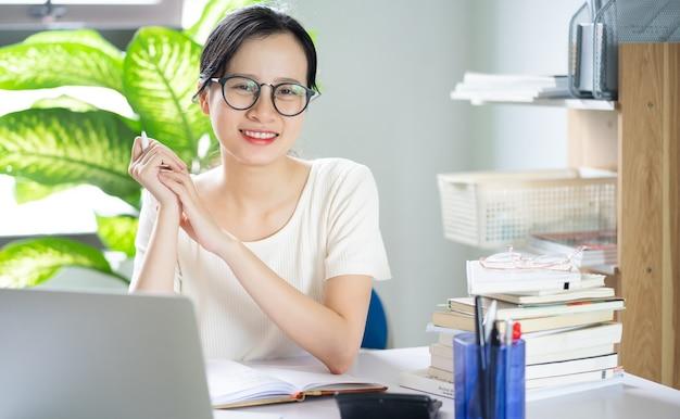 Asian young girl doing homework