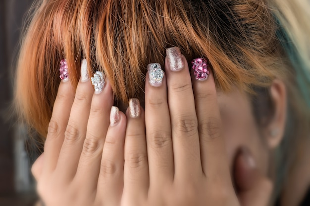 Asian young girl homemade fasion nail by oneself.