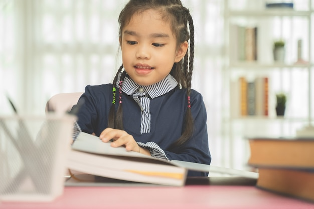 Asian young girl read a book