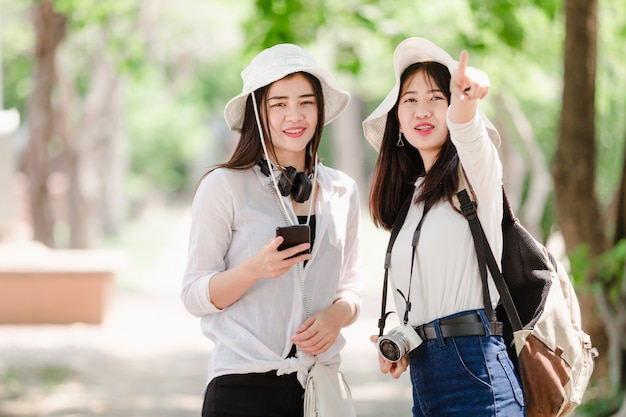 Asian young girls and friends traveler in city