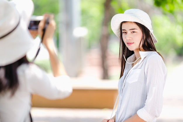 Asian young girls taking a photo