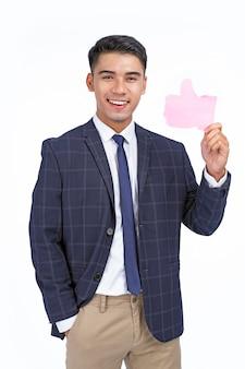 アジアの若いハンサムで陽気なビジネスマンはアイコンを保持します