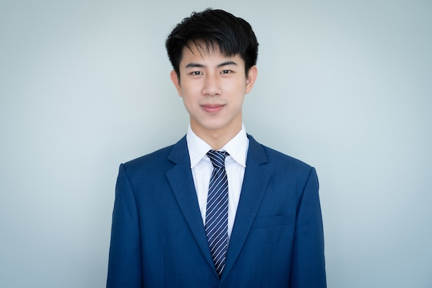 Asian young handsome man in blue suit