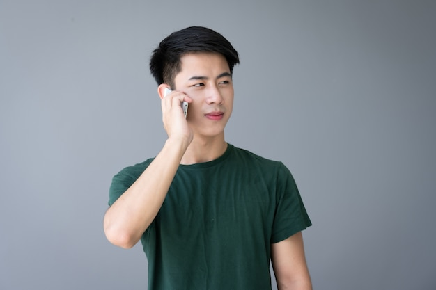 Asian young handsome man using smartphone