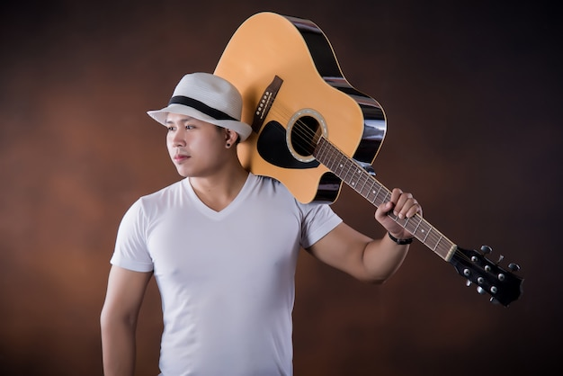 Asian young man  musician with acoustic guitar