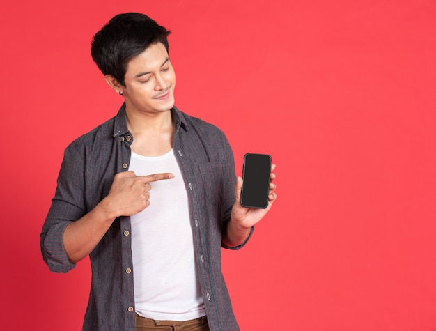 Asian young man use smartphone tablet