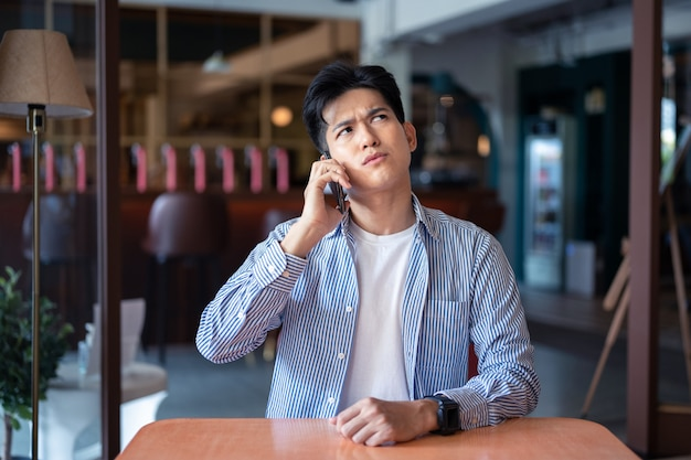 Asian young man with smartphone