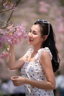 Asian young model with sunglasses outdoors in a forest.
