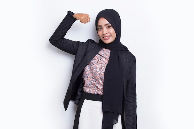 Asian young muslim business woman happy and excited celebrating victory expressing big success